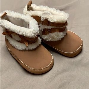 Tan baby boots with faux feather